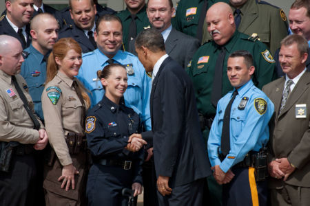 President Barack Obama talks with Sgt. Kimberly Munley, Directorate of Emergency Services, Ft. Hood Police Dept., after delivering remarks at a ceremony honoring the Top Cops award winners in the Rose Garden of the White House, May 14, 2010.   (White House Archive Phonto - Official White House Photo by Chuck Kennedy)