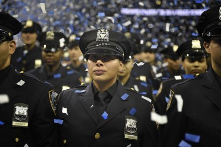 NYPD Academy graduate reacts to becoming a police officer at the NYPD Police Academy Graduation Ceremony at Madison Square Garden, 2014.  Credit: Diana Robinson/Mayoral Photography Office via Flickr