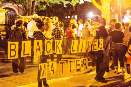 A crowd of community members gather outside the Governor's Residence in Saint Paul, Minnesota, in the 2 a.m. hour on July 7, 2016, following the police shooting of Philando Castile in Falcon Heights, Minnesota, by a St. Anthony Police officer. Photo: Tony Webster / tony@tonywebster.com